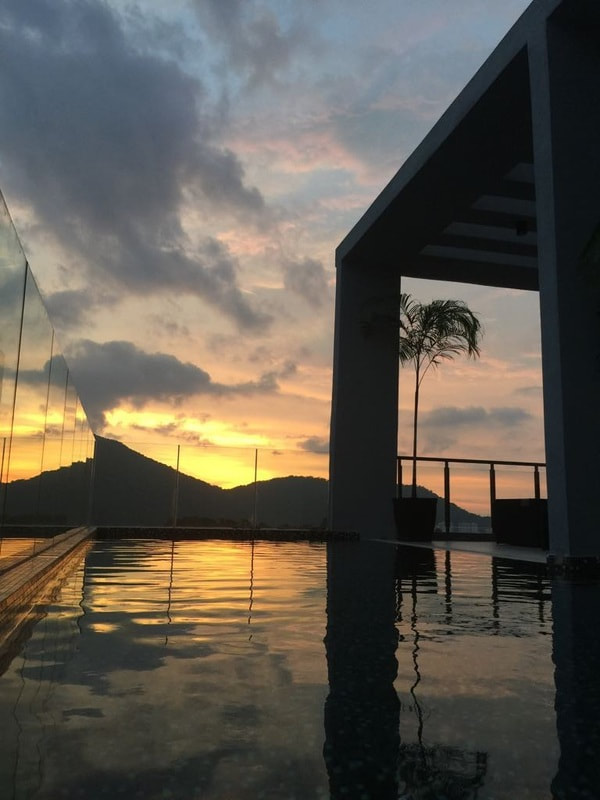 Rooftop infinity pool at sunset